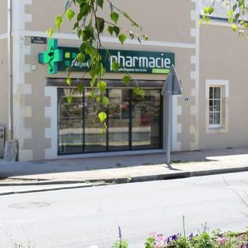 Transformation et extension d'un bâtiment ancien en Pharmacie 1